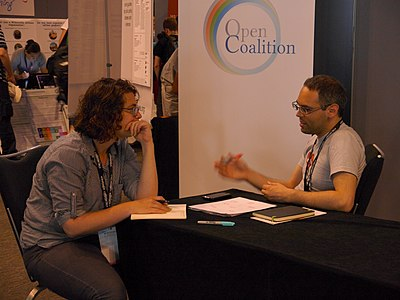 Bekka Kahn at the Open Coalition stand in the Wikimania 2014 communties village 01.jpg