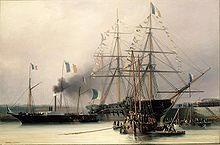 A large ship in docks with two smaller boats, lots of French flags on all of the vessels' rigging.