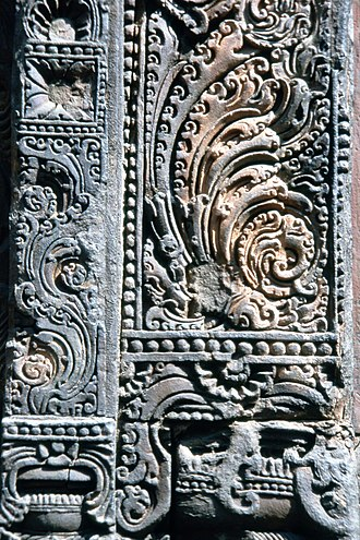 Kalasha - Relief detail on Baitala Deula temple with the symbol of Purna Kalasha surrounded by garlands.