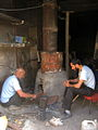 Blacksmith and his son in the Bazaar of Nishapur 4.JPG
