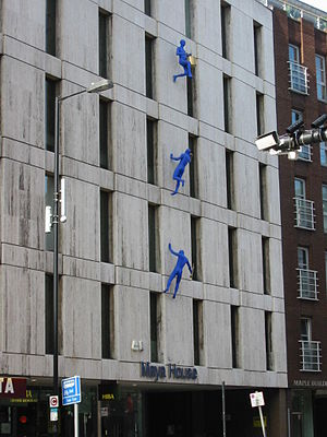 Borough High Street - Blue Men by Ofra Zimbalista climbing Maya House on Borough High Street (2007).