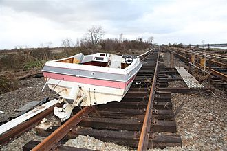 Effects of Hurricane Sandy in New York - Boat on the subway tracks of the IND Rockaway Line