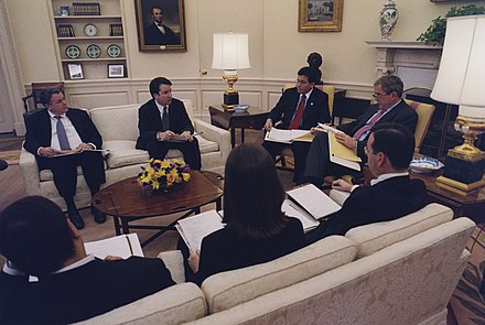 Kavanaugh (second from left) with President George W. Bush and White House staffers Brett Kavanaugh in the Oval Office.jpg