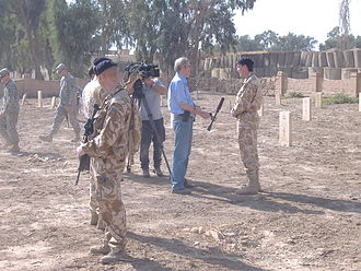 RAF Habbaniya - British media and service members make a brief visit to the cemetery for Remembrance Day ceremonies