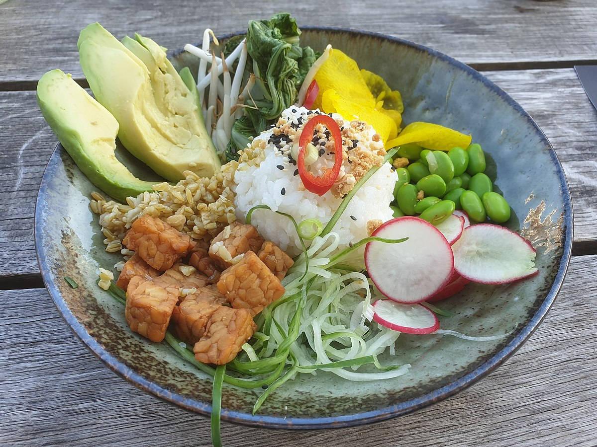 vegetarian meal, served on a bowl which consists of portions of several foods, served cold