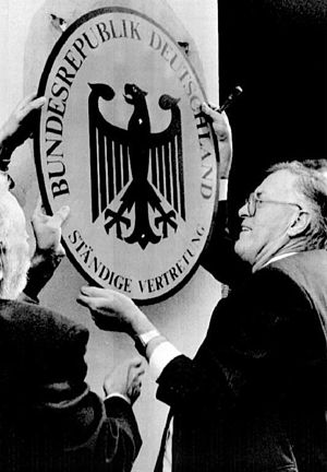 De facto embassy - On 2 October 1990, the last head of the West German Permanent Mission in East Germany, Franz Bertele, removes the shield from the office building following German reunification