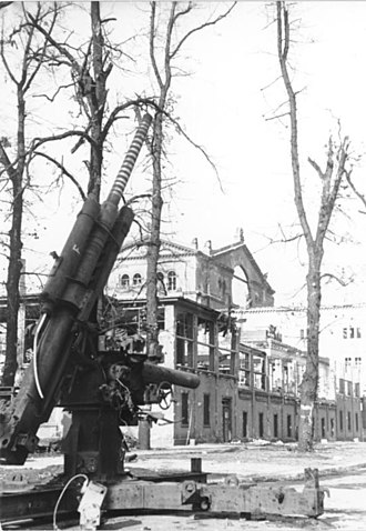 Kroll Opera House - Ruins of the Kroll Opera with an 88mm Flak cannon in the foreground, May 1945