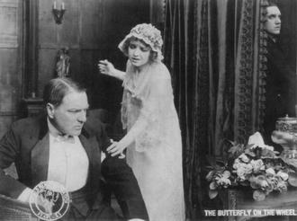 World Film Company - Scene from World Film's The Butterfly on the Wheel, starring Holbrook Blinn and Vivian Martin, 1915