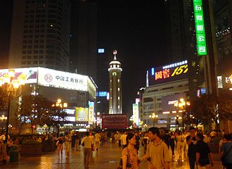 Jiefangbei CBD - Jiefangbei square at night, with the People's Liberation Monument in view.