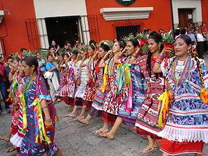 Papaloapan Region - Flor de Piña: Oaxacan women on parade in traditional apparel.