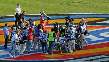Edwards celebrating after clinching the 2007 Busch Series Championship after the fall Texas race CarlEdwardsClenches2007BuschSeriesChampionship.jpg