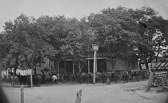 Battle of Old Church - Union cavalry horses photographed outside the Old Church Hotel by Timothy H. O'Sullivan, June 4, 1864