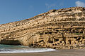 Caves cliff Matala shoreline Crete Greece.jpg