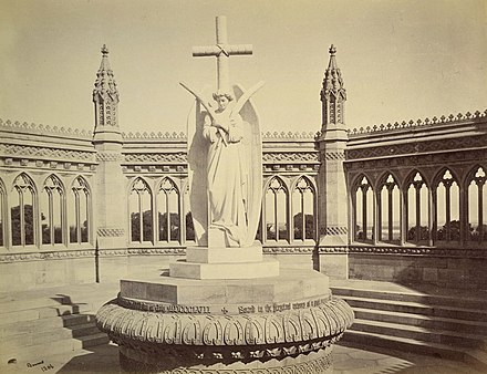 A memorial erected (circa 1860) by the British after the Mutiny at the Bibighar Well. After India's Independence the statue was moved to the All Souls Memorial Church, Cawnpore. Albumen silver print by Samuel Bourne, 1860 Cawnpore Memorial, 1860.jpg
