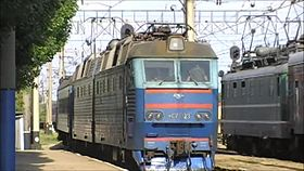 Файл:ChS7-123 with train arrives Saki station.webm