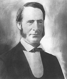 Young man with sideburns in 19th-century suit