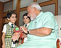 Children tying 'Rakhi' to the Prime Minister, Shri Narendra Modi, on the occasion of 'Raksha Bandhan', in New Delhi on August 10, 2014.jpg