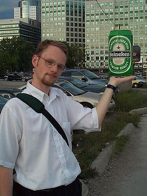 "Forced perspective - Forced perspective of giant beer can model shown ""perched"" on top of a person's hand."