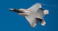 Cool shot of an F-22 Raptor with vapor burnoff (7674481990).jpg