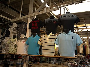 Counterfeit designer shirts on display at a fl...