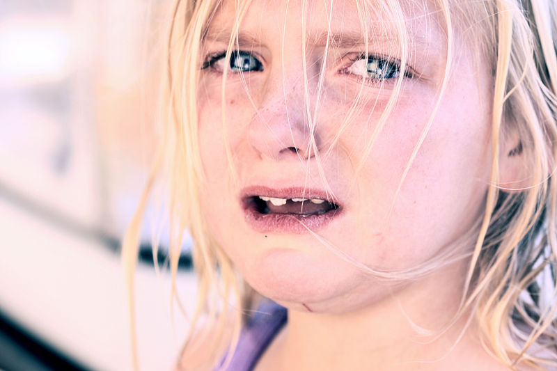 File:Crying child with blonde hair.jpg