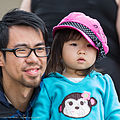 Cute Asian girl with pink hat, with her father, looking at the sea otters, 24 June 2013, Morro Bay, CA. (9136735565).jpg