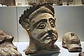 Cypriot Rural Sanctuary Stone Head at ROM.jpg