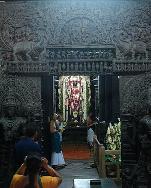 Garbhagriha - Devotees offering prayers at the Garbhagriha in Chennakesava Temple at Belur, which houses the icon of the god Vishnu.
