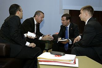 2009 G20 Pittsburgh summit - Dmitry Medvedev and Recep Tayyip Erdogan with interpreters in the foreground.