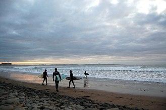 Doonbeg - Surfers survey the waves at Doonbeg (Doughmore) beach.