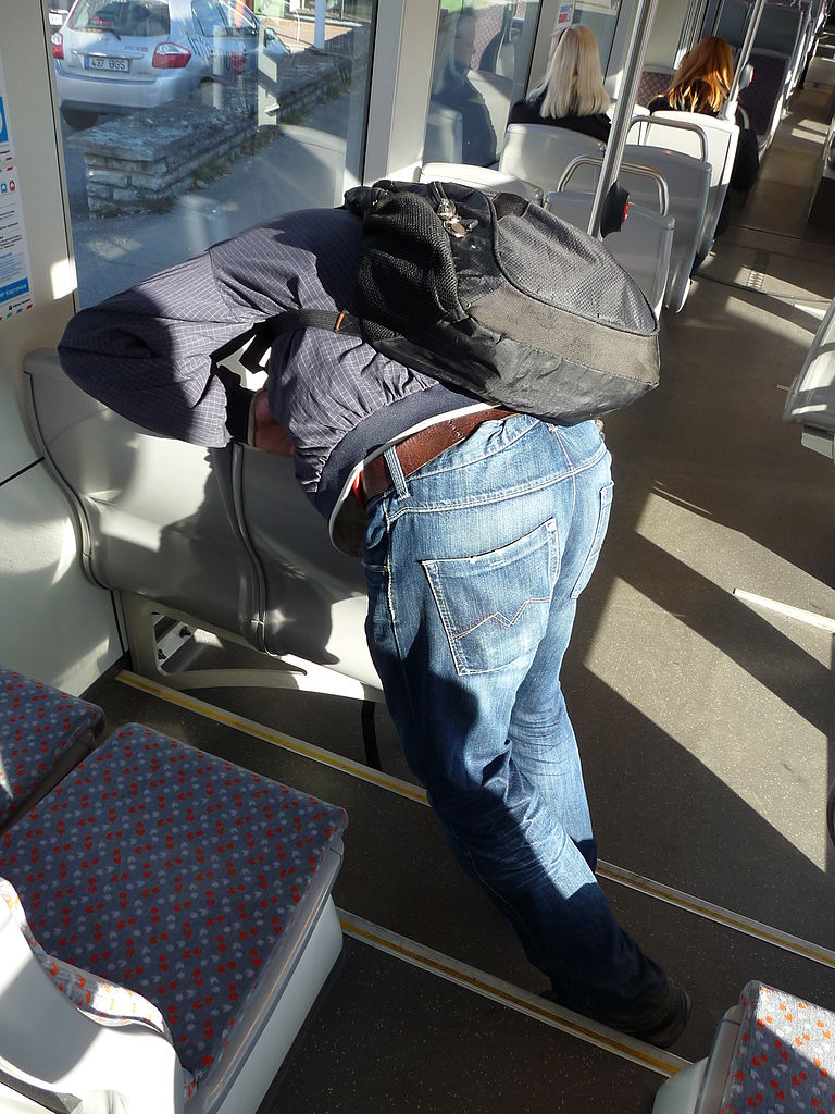 File:Drug addict in CAF tram.JPG