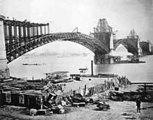 Photograph of the Eads Bridge under construction in 1874 showing its girders and piers