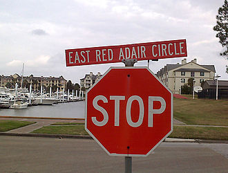 Red Adair - The roads around South Shore Harbour Marina in League City, Texas, where Red Adair kept his boat, were named after him.