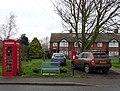 Elizabeth II postbox and telephone box on Main Street, Welwick (geograph 6376416).jpg