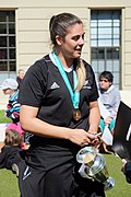 Eloise Blackwell holding Women's Rugby World Cup trophy while talking with fans.jpg