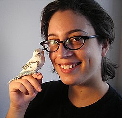 Modern young woman and her pet bird.