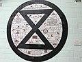 Extinction symbol by artist Carrie Reichardt.jpg