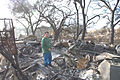 FEMA - 33644 - Resident and the debris from his home in California.jpg