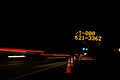 FEMA - 40049 - FEMA 1 800 621-3362 phone number on a sign at night in Washington.jpg