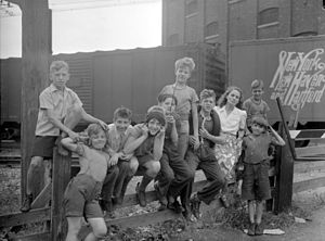 Gabrielle Roy - Gabrielle Roy in 1945 with boys from Saint-Henri, the working-class neighbourhood of Montreal where The Tin Flute takes place.