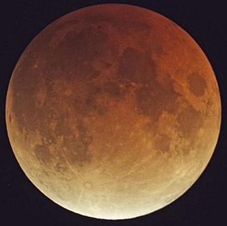 Earth's shadow - A total lunar eclipse on February 21, 2008, shows the reddish light falling on the moon's surface.