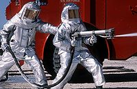 Fire fighters practice with spraying equipment, March 1981.jpg