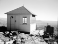 Fire lookout on Lava Point, Building 139 with view from point. ; ZION Museum and Archives Image ZION 7972 ; ZION 7972 (ad190e8ae9714978bed1186501950456).tif