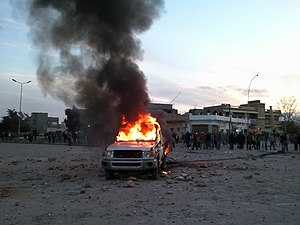 Libyan Civil War (2011) - The first demonstrations in Bayda. A police car burns on 16 February 2011, at the crossroads of At-Talhi, now known as the Crossroads of the Spark.