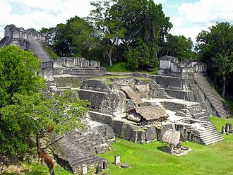 Tikal Temple 33 - Only the base of Temple 33 now survives, here occupying the centre of the photo