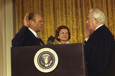 Gerald Ford is sworn in as the 38th President of the United States by Chief Justice Warren Burger in the White House East Room, while Betty Ford looks on. Ford sworn-in.jpg