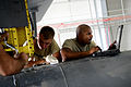 From left, U.S. Air Force Senior Airman Jessie Mechling, an electronic warfare systems journeyman, and Tech. Sgt. Daniel Schultz, an electronic warfare systems craftsman, both with the 41st Expeditionary 140825-F-PB969-028.jpg