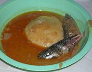 Fufu in groundnut soup with fish.jpg