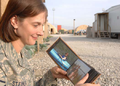 GI looks at photos from home at Bagram Air Field, Afghanistan.png