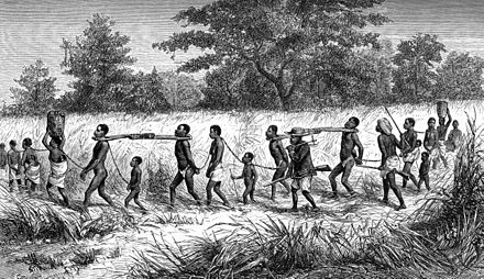 Slave traders and their captives bound in chains and collared with 'taming sticks'. From Livingstone's Narrative Gang of Captives at Mbame's.jpg